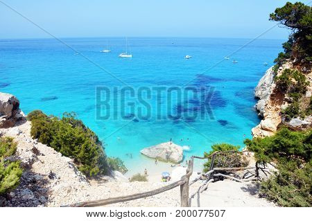 Sea of Sardinia, summer vacation in Italy. Crystal clear, clear, blue, emerald and turquoise waters of Sardinia. White sand.