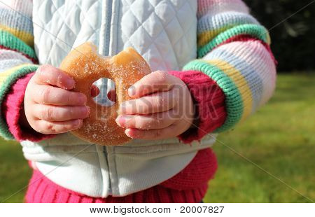 Child Snacking On Unhealthy Sugary Donut