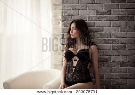 charming beautiful woman in lingerie in studio