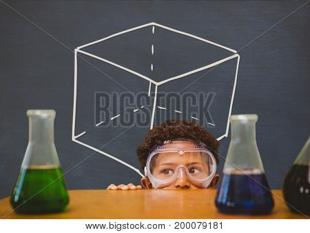 Digital composite of Student boy hiding behind a table against blue blackboard with school and education graphic