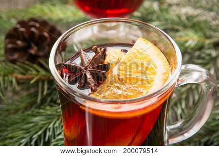 Christmas tradition drink. Hot Mulled wine with cinnamon, anise and orange. Close up, selective focus.