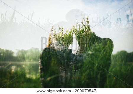 double exposure of couple in love and reeds on lake