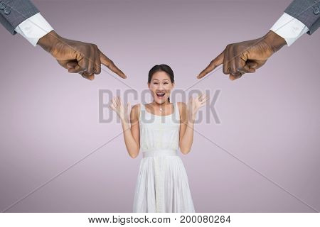 Digital composite of Hands pointing at surprised business woman against pink background