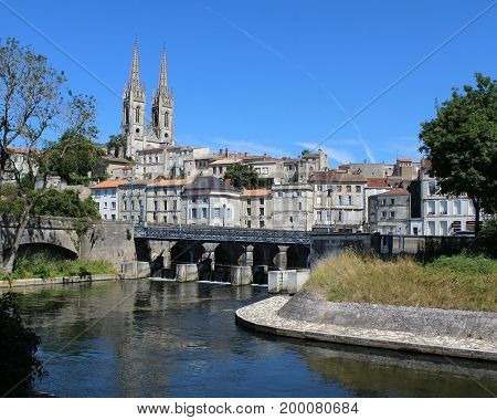 A view of the historic town of Niort and St Andre's church, on the Sevre Niortaise River, in the Deux-Sèvres department in western France.