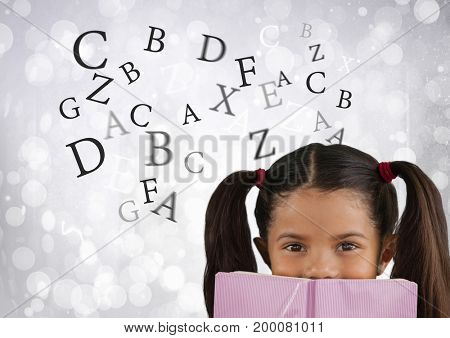 Digital composite of Many letters around Girl reading in front of bright bokeh background