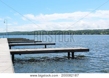 Boat docks on Canandaigua Lake in the sun