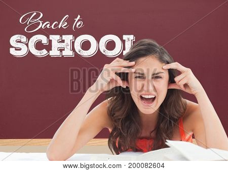 Digital composite of Frustrated student girl at table against red blackboard with back to school text