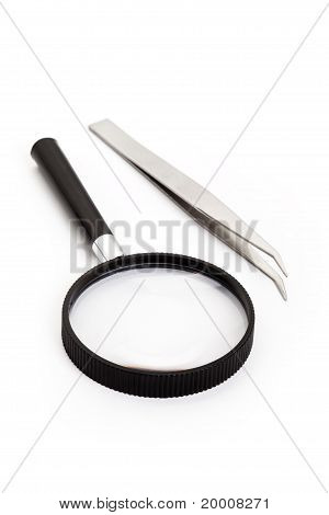 Tweezers And Magnifying Glass