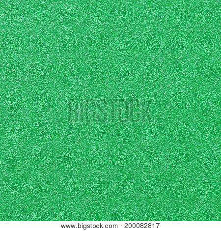 A digitally created aqua green glitter paper background texture.