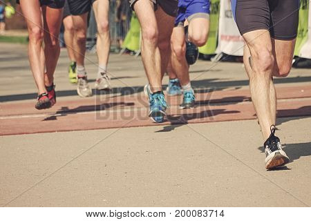 Group of marathon runners, running race people feet
