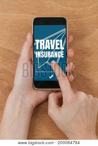 Digital composite of Person using a phone with travel insurance concept on screen