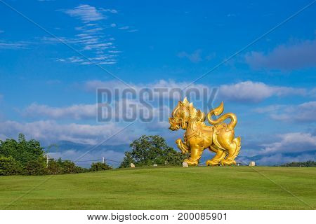 Singha statue at Singha Park Chiangrai Thailand. Gold Lion statue in Boonrawd farm. Popular and famous in vacation for tourist.