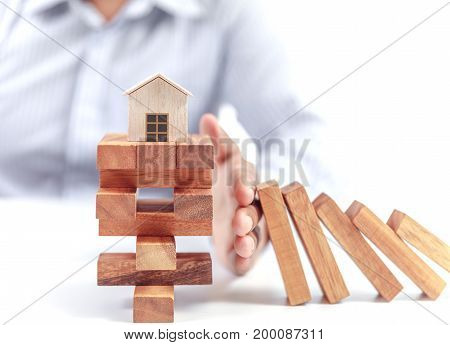 home insurance concept, wooden model home on white background