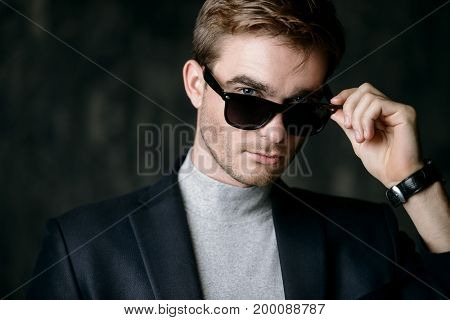 Business concept. Portrait of a handsome businessman wearing suit and sunglasses.
