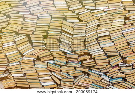 Background of old, antique books, in a bookstore