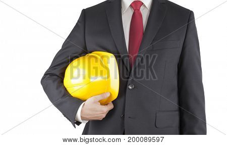 Engineer in black suit holding yellow helmet isolated on white with clipping path