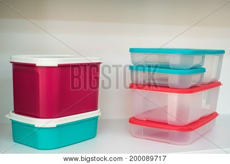 Close up modern colorful plastic food boxes on shelf