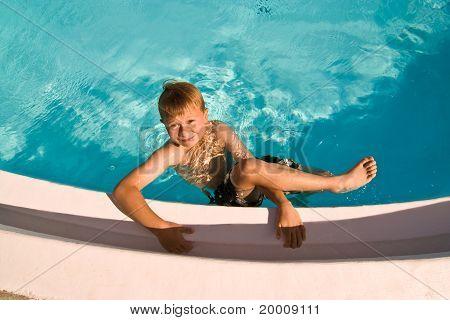 boy has fun in the pool