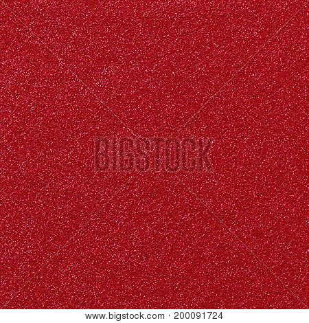A digitally created metallic red glitter paper background texture.