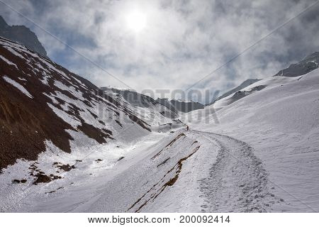 Trekking path in the mountains Thorong La Pass Himalayas Annapurna Conservation Area Nepal.