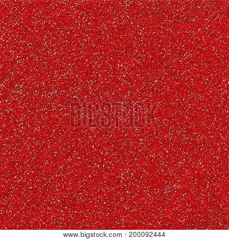 A digitally created red glitter paper background texture.