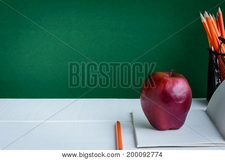 Books Pencil And Apple On A White Wooden Table