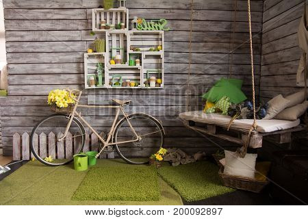 Room With Wooden Walls With An Old Bicycle