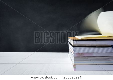 Book On White Table Black Board Background