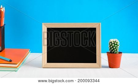 Blackboard With Mock Up Frame And Book Pencil On The Wood Table