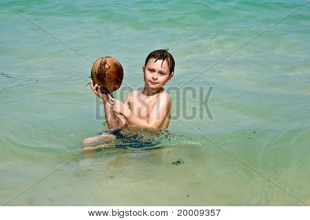 cute young boy at the beautiful beach