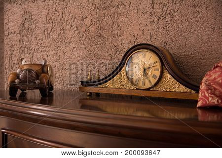 Antique Desk Clock And Auto On The Chest