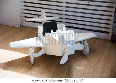 Wooden Toy Airplane On A Wooden Floor