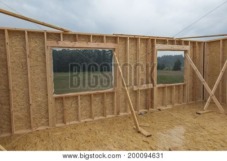 Rain while building a home in skeleton technology sealed walls and wood floors and particleboard