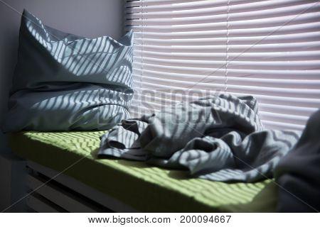 Pillow On The Windowsill Is Illuminated Through