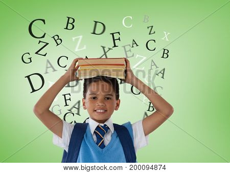 Digital composite of Many letters around Schoolboy holding books in front of green background