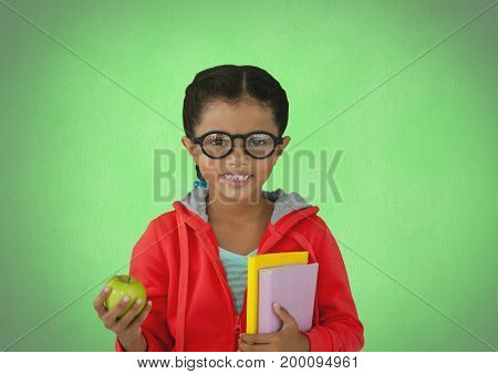 Digital composite of Girl with apple and books in front of green background