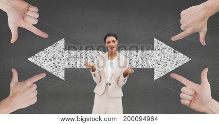 Digital composite of Hands pointing at confused business woman against grey background with arrows