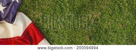 Digital composite of USA flag on grass