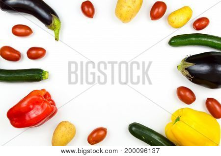 Raw food vegetables isolated on white background with copy space pepper eggplant tomato potato and zucchini