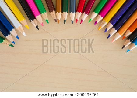 Back to school supplies stationery colorful pencils accessories on wooden background Top view flat