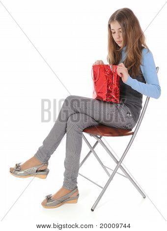 Girl Looking In Bag