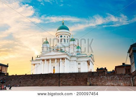 Finland, Helsinki Lutheran Cathedral, The Famous Landmark With Tall Blue Dome Surrounded By Four Smaller Domes, The Building In Neoclassical Style In Summer Sunset Evening Under Dramatic Blue Cloudy Sky