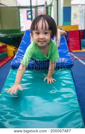 Asian Chinese Little Girl Playing Alone