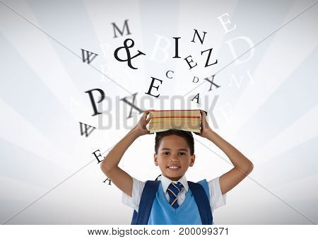 Digital composite of Many letters around Schoolboy holding books on head with bright background