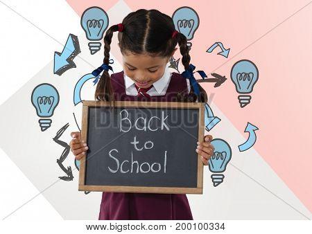 Digital composite of Girl holding back to school blackboard with light bulbs