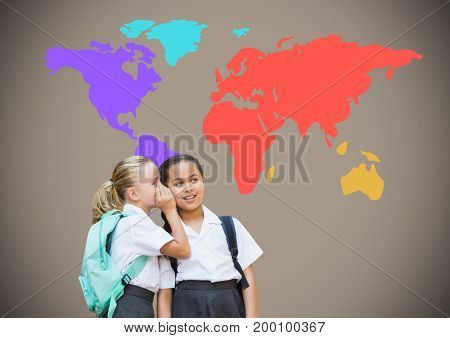 Digital composite of School girls whispering in front of colorful world map