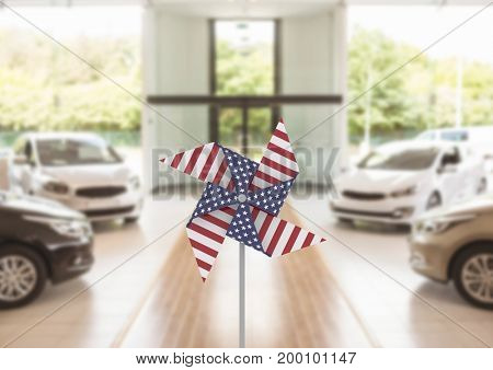Digital composite of USA wind catcher in front of car sales