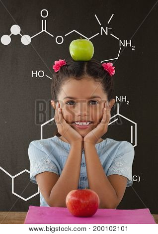 Digital composite of Happy student girl at table against grey blackboard with school and education graphic