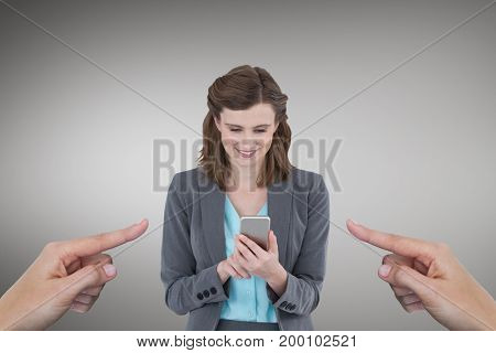 Digital composite of Hands pointing at happy business woman using her phone against grey background