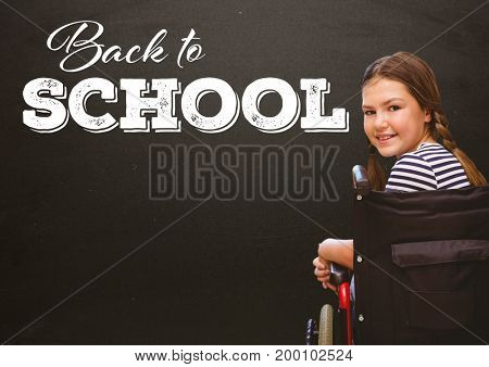 Digital composite of Back to school text on blackboard with disabled girl in wheelchair